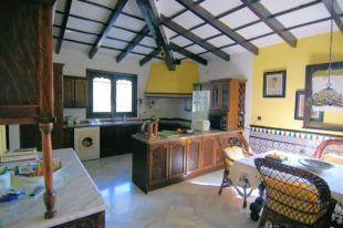 Large, country kitchen with vaulted ceilings