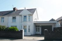 semi detached house in 45 Coychurch Road...