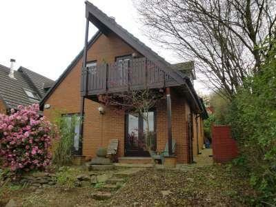 Scandiavian style house adjoining farmland