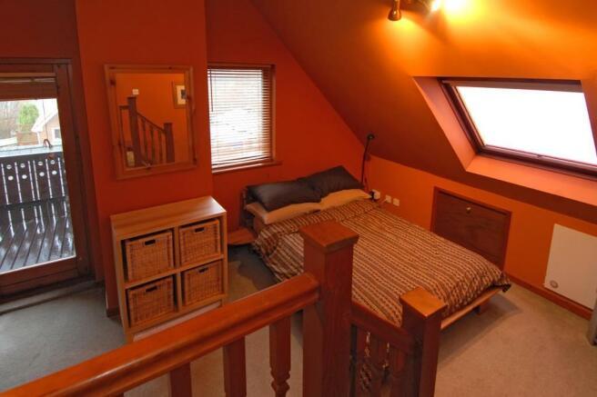 Master bedroom with door to balcony