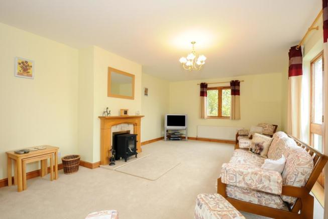 Full length sitting room with doors to terrace
