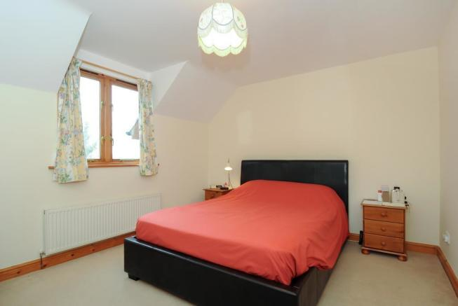 One of four good sized bedrooms