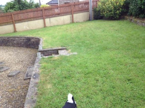 Lawned rear garden with terrace area