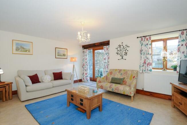 Sitting room with glazed door to rear garden