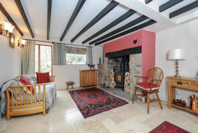 Wood burner in lovely intimate sitting room