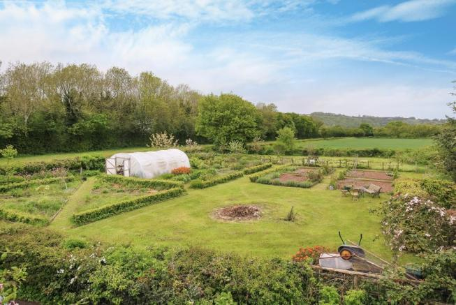 Views over kitchen garden to countryside