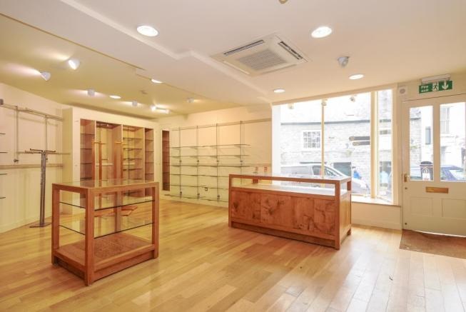 Very light retail area with 2 large windows