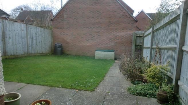 Enclosed garden with access to garage and parking