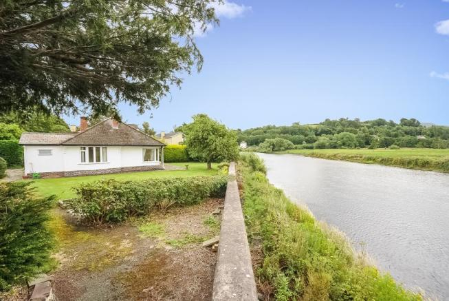 Mature bungalow on the river bank
