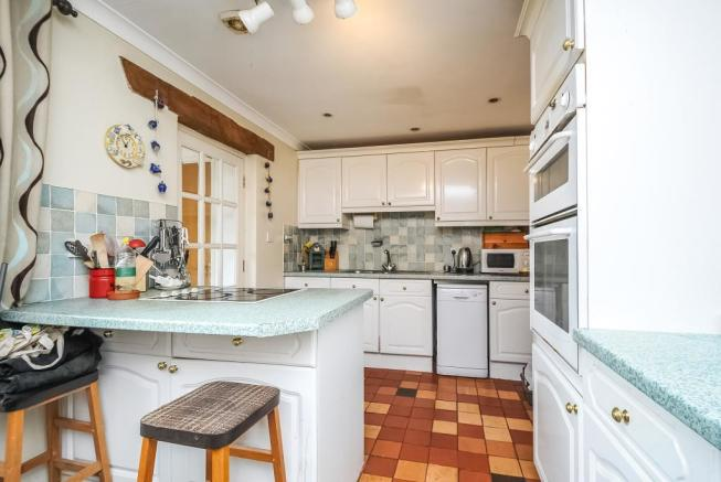 Fitted kitchen area with breakfast bar