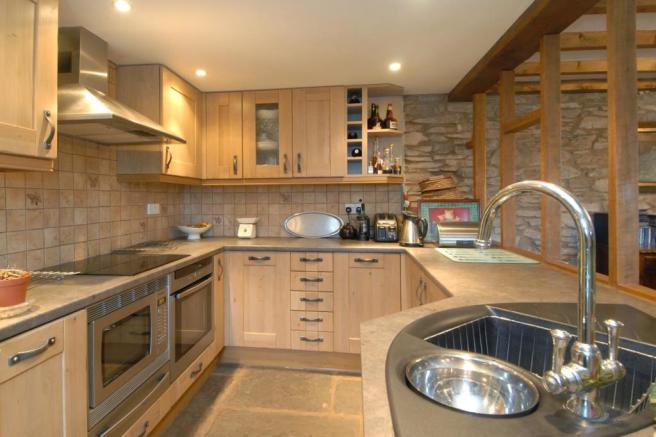Well fitted kitchen with appliances