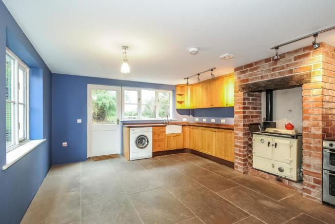 Lovely spacious living room with woodburner