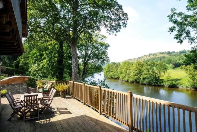 Full width terrace with views over river meadows