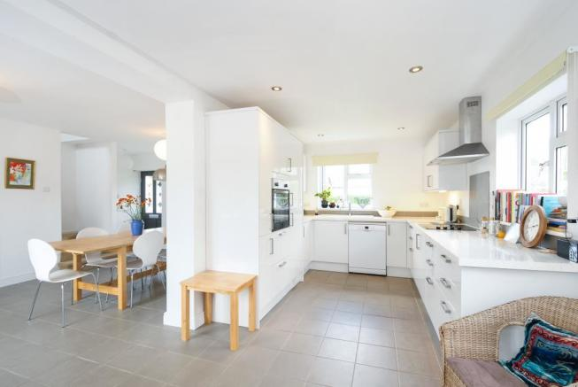 Fitted kitchen with dining room