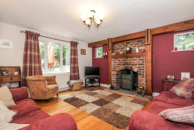 Spacious sitting room with wood burner