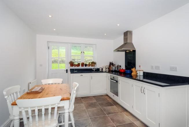 Fitted kitchen with space for a breakfast table