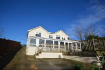 Detached property in Noke Common