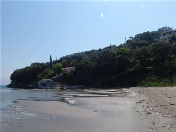 sandy beach in front of the villa