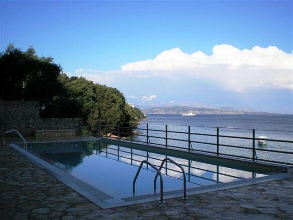 swimming pool next to the sea