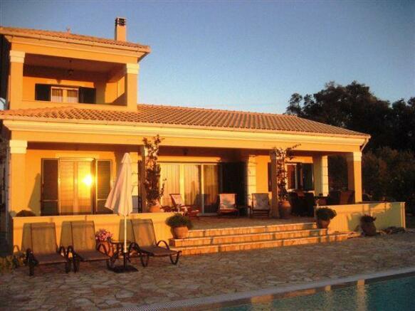 the villa in the setting sun