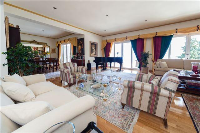 living room and dining room with doors onto veranda