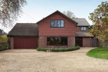 Detached house in Knowle Wood Road...