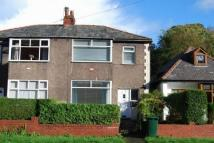 semi detached house in Burnley Road East...