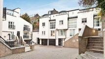 Terraced home in Peony Court Park Walk...
