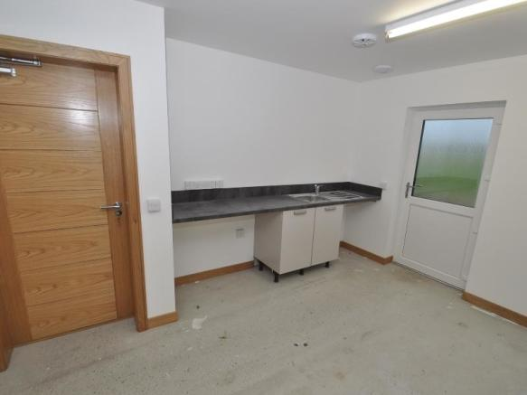 Utility area within integral garage