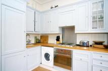 Flat to rent in Waldemar Avenue, London...