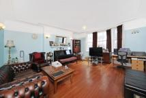 Flat in Southampton Row, London...