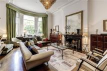 Terraced property in Ennismore Gardens...