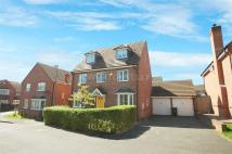 Detached house in Harrington Croft...