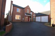 Detached property in Harrington Croft...