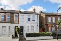 semi detached home in Robinson Road, London...