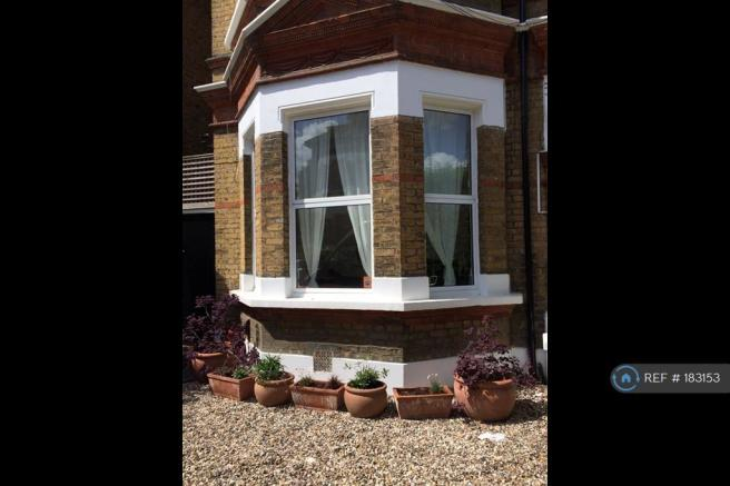 Front Of House Showing Bay Windows To Flat
