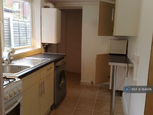 Kitchen Silent Washing Machine And Gas Cooker