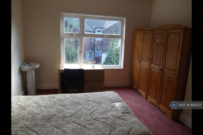 Upstairs Bedroom With Sink