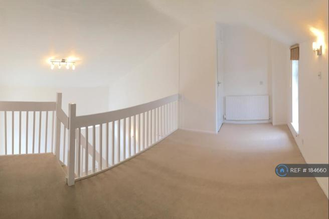 Galleried Bedroom With Access To Walk In Wardrobe