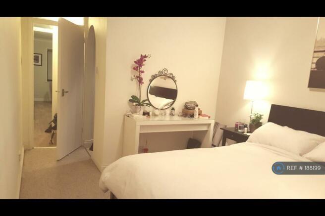Bedroom  ( Walk In Wardrobe Behind Arch Door)