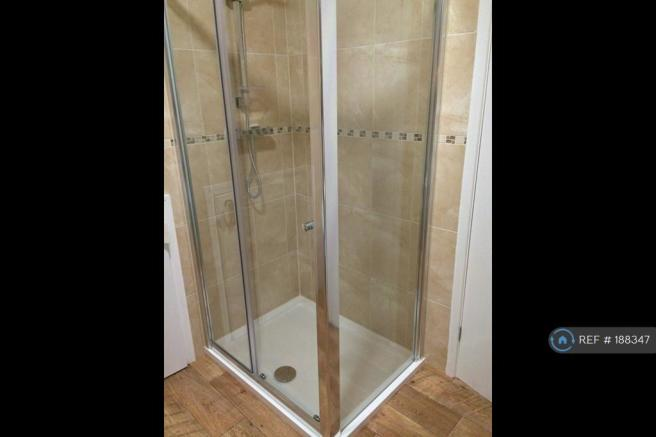 Large Shower In One Of Shared Bathrooms