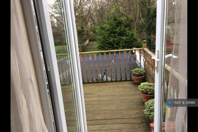 Through French Doors To Roof Decking