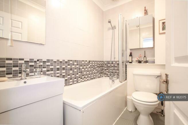 Bathroom With Full Sized Bath And Shower Over Bath