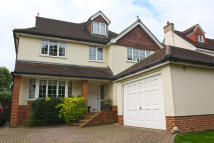 Detached property in Tolmers Road...