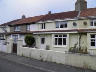property in The Crescent, Camborne...
