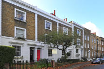 Terraced property in Cleaver Square, London...
