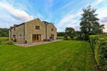 Detached home in **THE BARN**North Street...