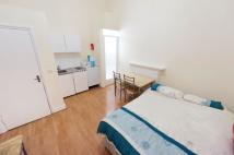 Studio apartment in Earls Court Road, London...