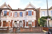 Terraced property in Englewood Road, London...