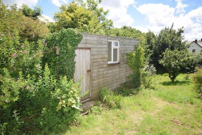 Storage shed with car port under